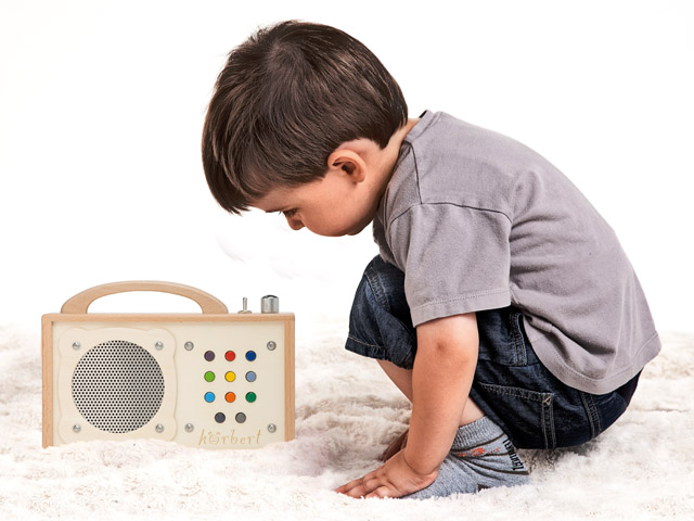 A child is listening to its audio player.
